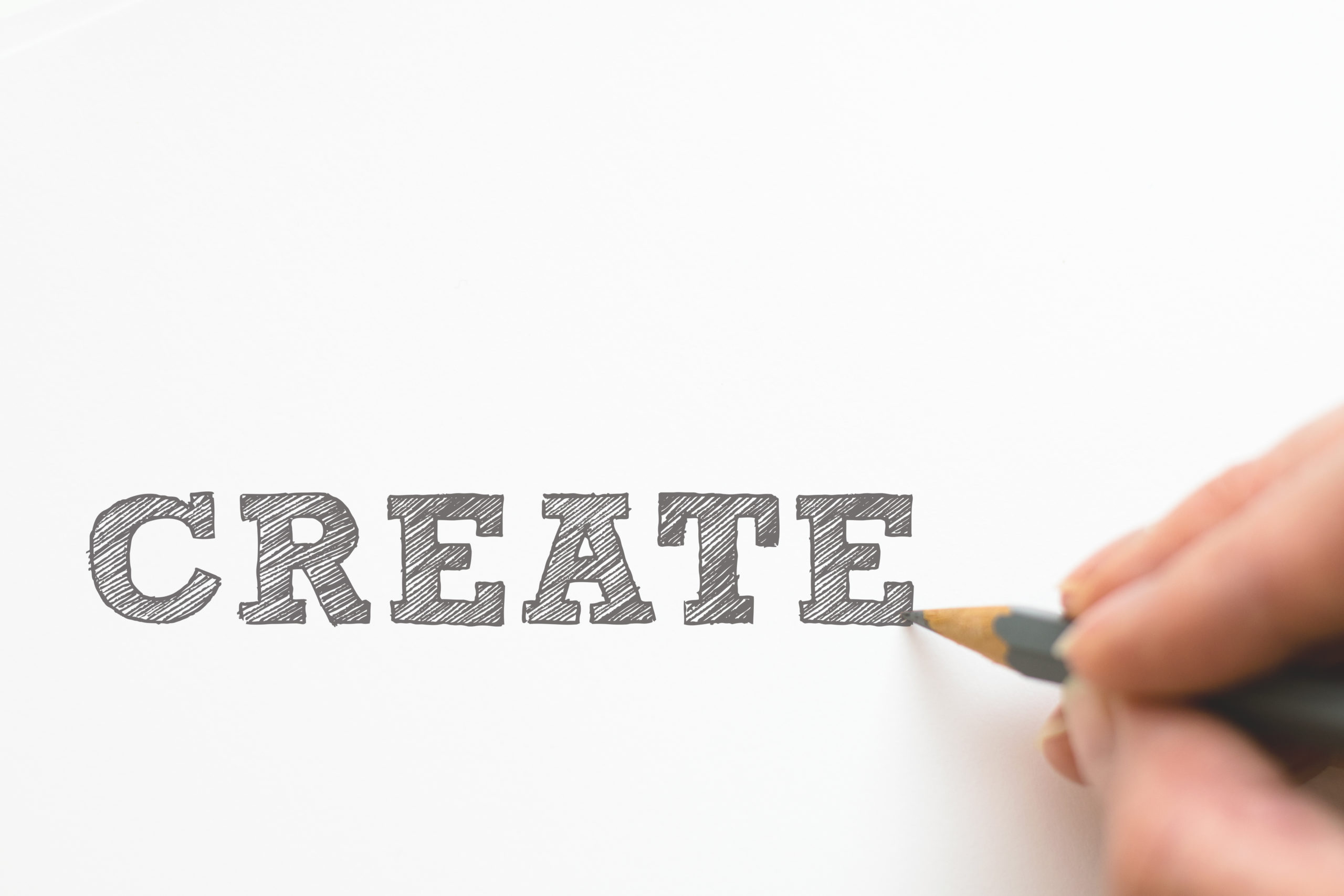 """Create"" word written with pencil"